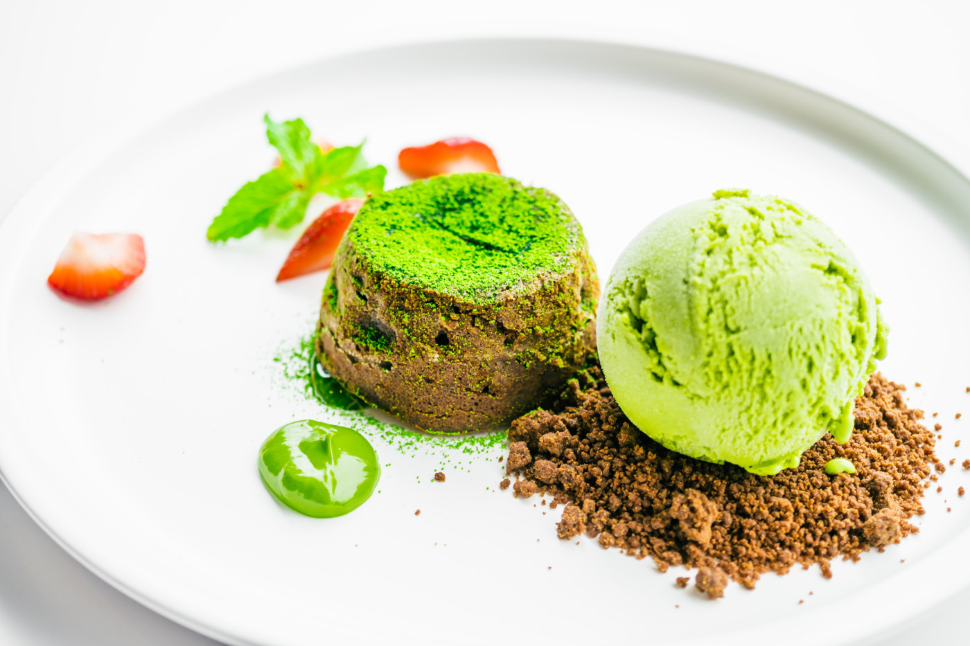 Sweet dessert and Green tea chocolate lava with ice cream and strawberry in white plate - Color Filter Processing